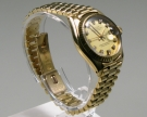 Rolex Oyster Perpetual Datejust, Lady, 18 K. Gelbgold 26 mm, Zustand gut (2)